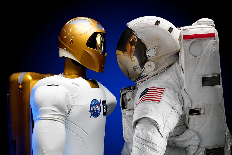 Two people wearing white and gold helmets