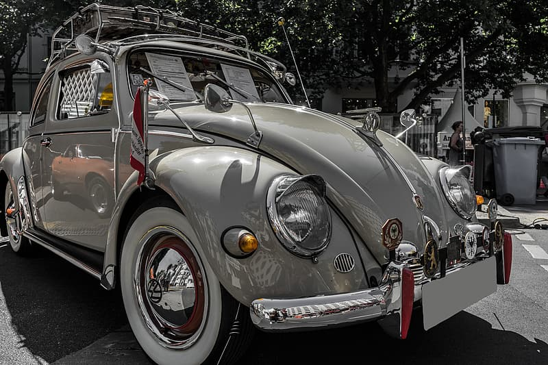 Silver volkswagen beetle parked on street during daytime