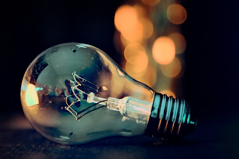 Clear light bulb with bokeh lights