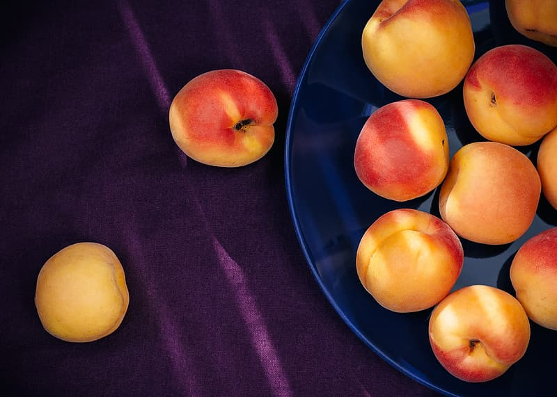 Yellow-and-red apple fruits on plate