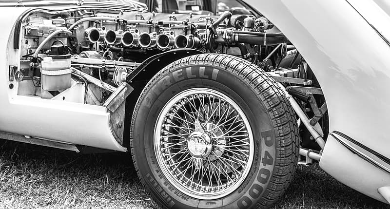 Grayscale photo of vintage vehicle