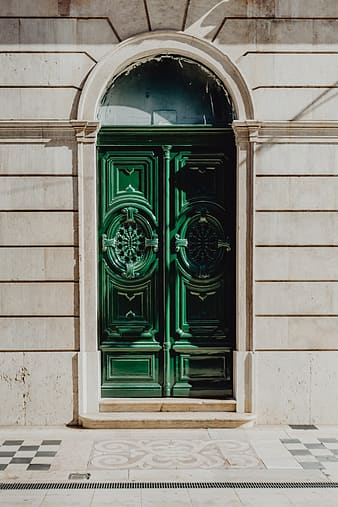 Colorful wooden door in the facade of a typical Portuguese house at Lisbon, Portugal