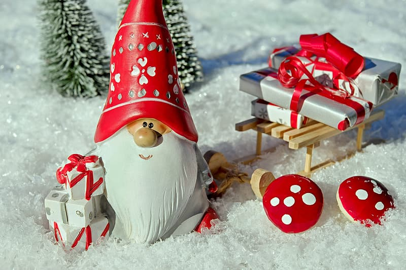 Closeup photo of gnome with presents and pine tree