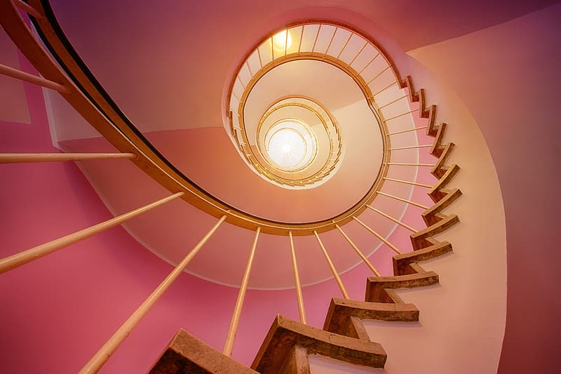 White spiral staircase with blue metal railings