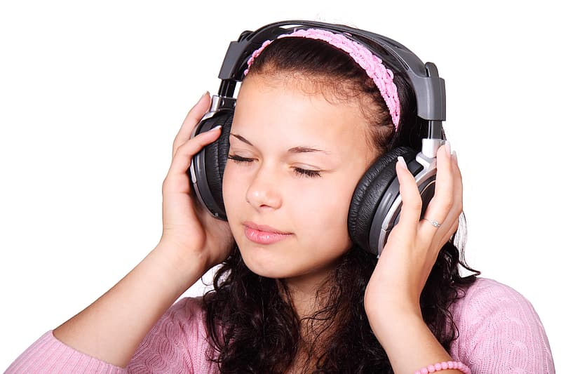 Girl wearing black headphones and pink knitted cap