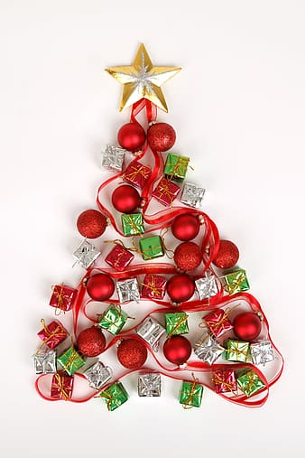 Red christmas baubles with miniature gift boxes and beige star