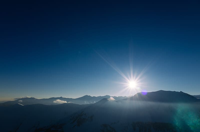 Silhouette of mountains under blue sky during daytime