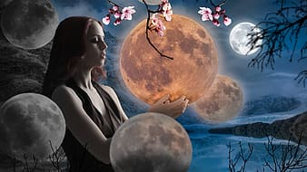 Woman holding moon with body of water in background wallpaper