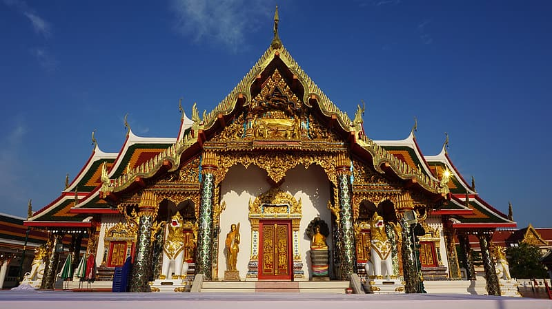 White and brown pagoda under blue sky