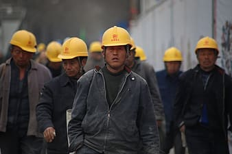 Man wearing yellow hardhat