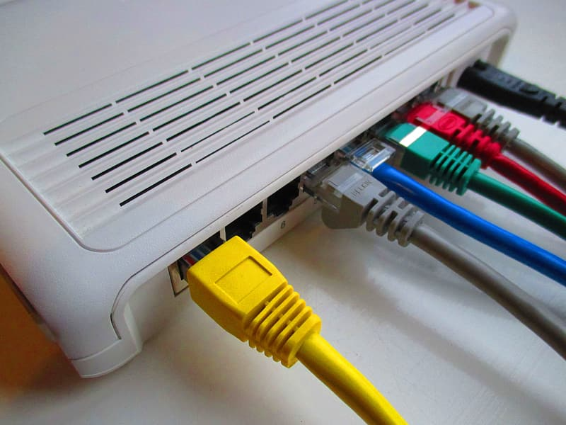 Assorted-colored wires connected through gray router