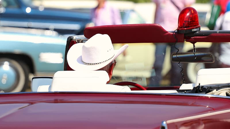 White cowboy hat on red car