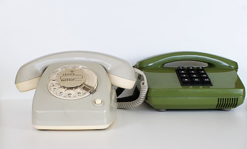 Green and white telephones