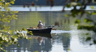 Man rowing a boat on river