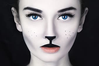 Woman in black lipstick and blue eyes photo