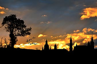 Silhouette of church during daytime