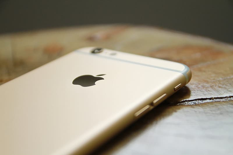 Gold iphone 6 on brown wooden table