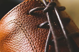 Brown leather textile in close up photography