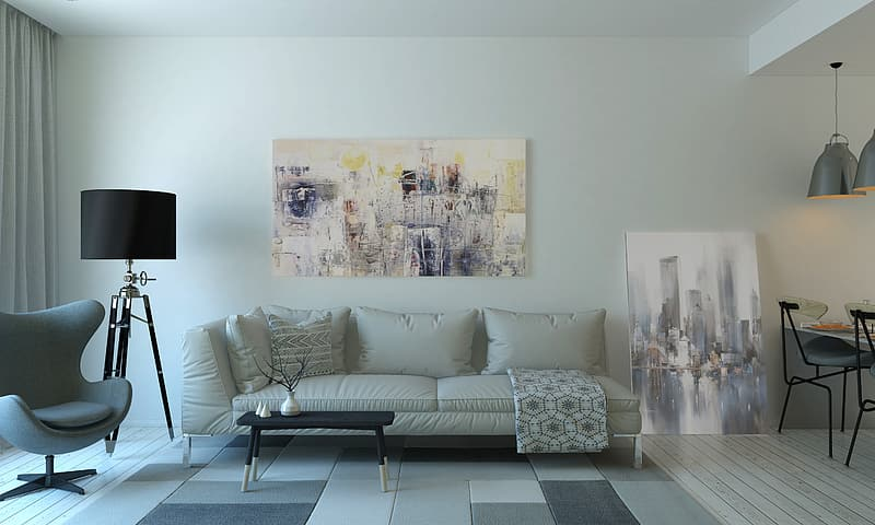 White leather sofa in front of painting on wall