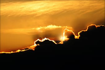 Yellow sunlight covered by clouds