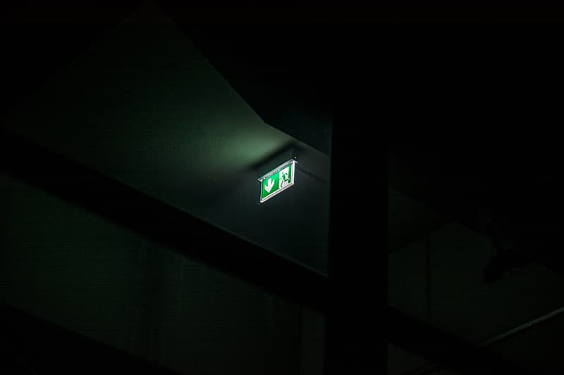 Green and white exit signage