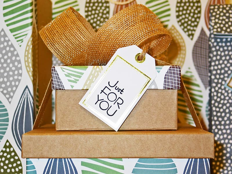 Brown-green-and-teal gift box with just for you tag