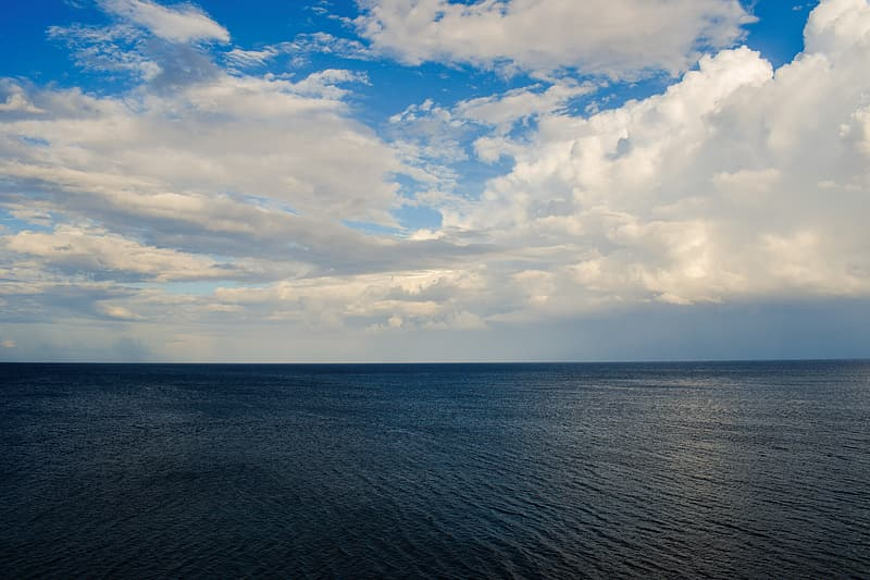 Ocean under cloudy sky at daytime