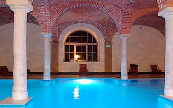 Blue indoor pool during nighttime