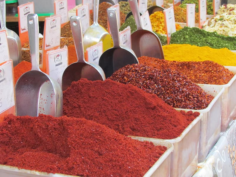 Assorted spices on white plastic bins
