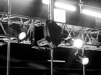 Grayscale photography of turned on stage spotlights