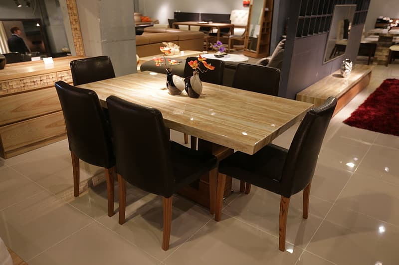 Brown wooden table and six black parson chairs dining set