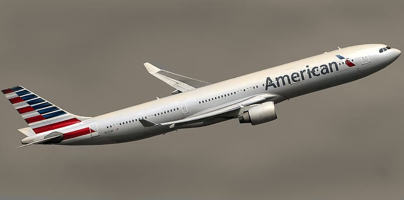 White American airplane flew in mid air