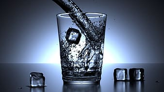 Clear drinking glass with water and ice cubes