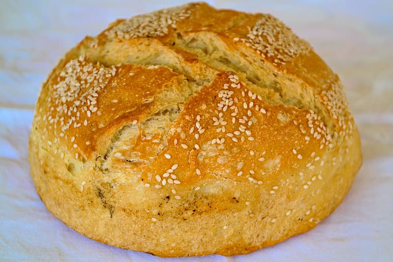 Baked bread on white surface