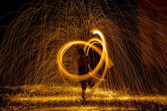 Steel wall photography of person dancing during nighttime