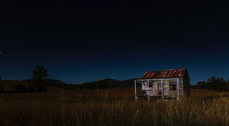 Long exposure photograph of house on grass field