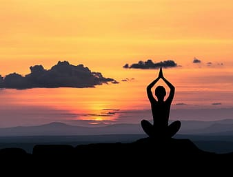 Silhouette of person taking yoga pose