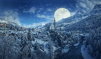 Village covered with snow beside tress and mountain during full moon