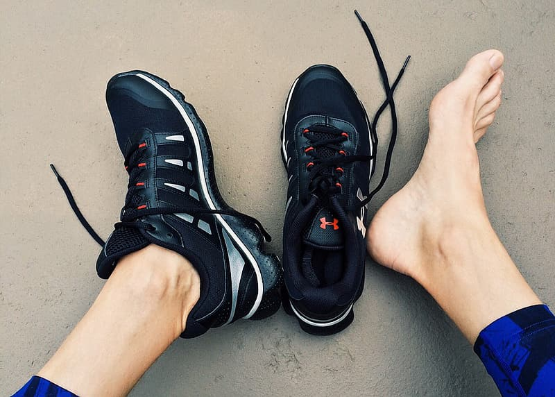 Black-gray-and-white Under Armour running shoes