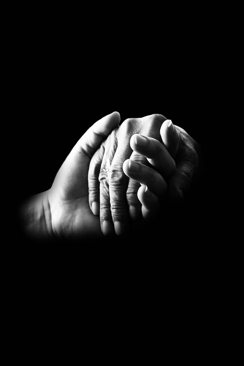 Grayscale photo of two hands holding each other