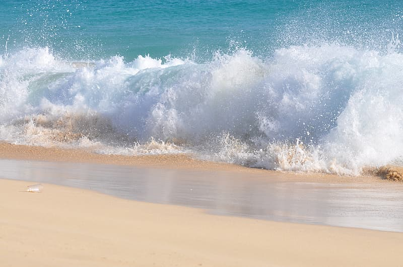 Ocean and sand during daytime