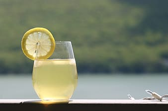 Drinking glass filled with lemon juice