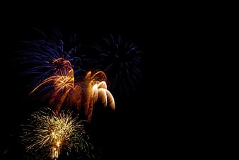 Orange, yellow, and blue fireworks
