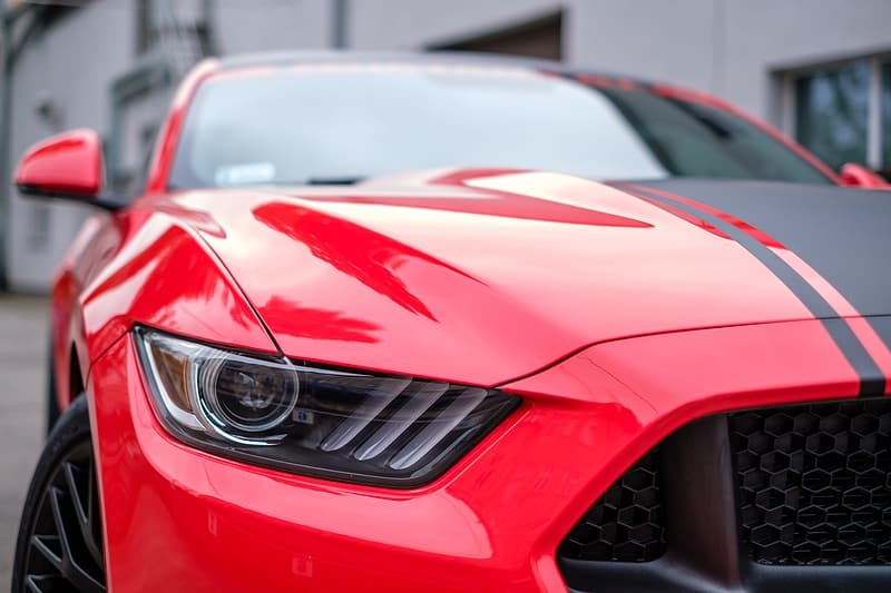 Photography of red and black Ford Mustang