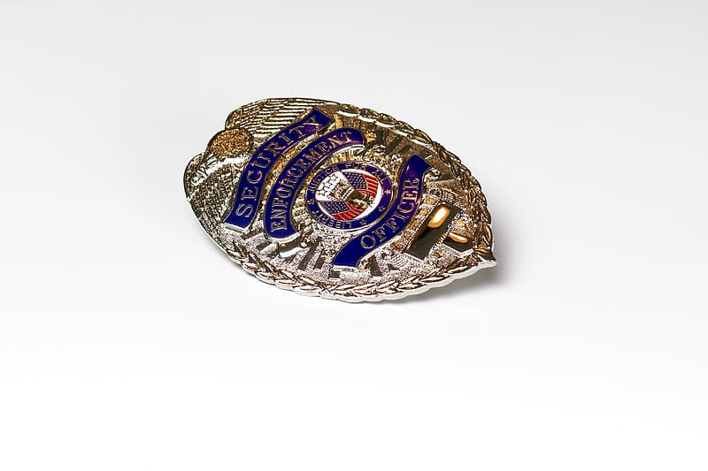 Silver and blue security badge