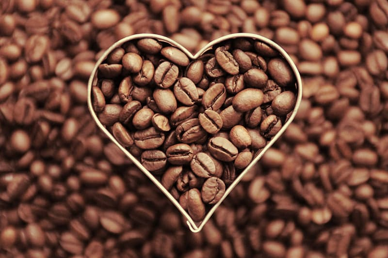 Coffee beans on white paper