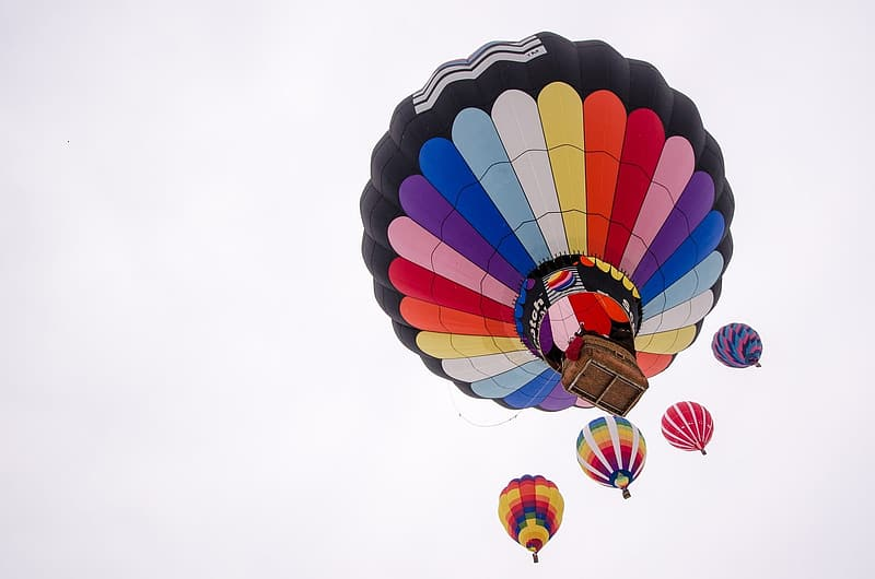 Low-angle photography of multicolored hot air balloons