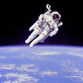 Photo of astronaut floating above earth