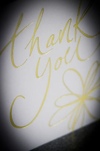 Closeup photo of white and yellow thank you card
