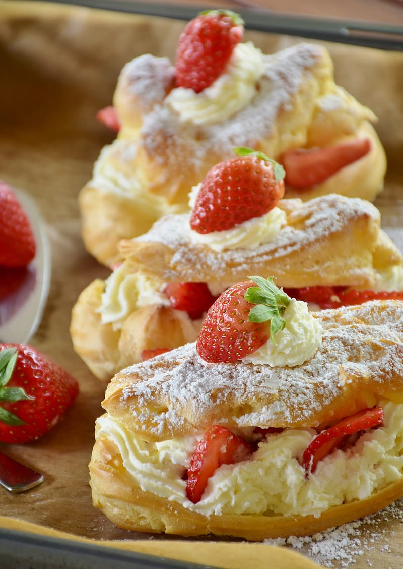 Pastries with cream and strawberries